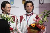 KIEV, UKRAINE - APRIL 14, 2012: Hungarian fencers Andras Redli and Gabor Boczko on medal ceremony du