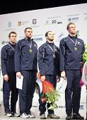 KIEV, UKRAINE - APRIL 14, 2012: USA men's epee team on medal ceremony during World Fencing Champions