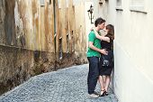 Young Couple In Love Walking On A Street Of European City. Sightseeing Traveler poster