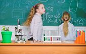 Microscope And Test Tubes On Table In Classroom. Kid Near School Chalkboard Background Defocused. Sc poster