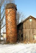 Old Silo And Barn In Winter
