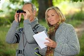 Couple with binoculars