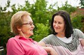 Outdoors talking - women