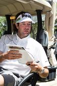 JACKSONVILLE, FLORIDA-APRIL 14: Professional Golfer Bubba Watson signing autographs at the Tim Tebow
