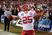SAN DIEGO - DEC 30: Nebraska Cornhuskers TE Kyler Reed #25 celebrates a TD during the 2010 Bridgepoi