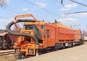 Постер, плакат: Железнодорожная тяжелых машин поезд на станции