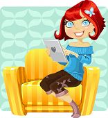 cute redhaired girl with a laptop in a yellow armchair