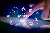 Finger touching tablet with drawn social media icons and SOCIETY inscription, social networking conc poster