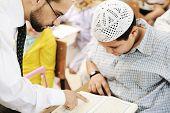 Children at school classroom, reading Koran (no copyright infringements for Koran)