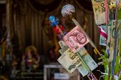The Background Of Thai Baht Notes Decorated On The Money Tree For Buddhist Temple Donation As An Off poster