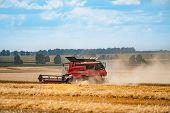 Combine Harvester In Action On The Field. Combine Harvester. Harvesting Machine For Harvesting A Whe poster