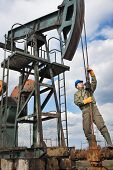 worker in the oil industry on oil pump