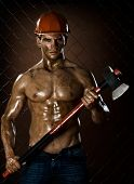 stock photo of ax  - the beauty muscular worker chopper man in safety helmet with big heavy ax in hands on netting fence background - JPG