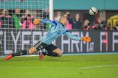 VIENNA,  AUSTRIA - OCTOBER 16:  Andrei Sidelnikov (#22 Kazakhstan) deflects the ball during the WC q
