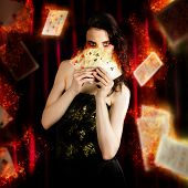 image of clairvoyant  - Creative Fine Art Photo Of A Beautiful Mystic Magician Holding Flaming Cards In A Depiction Of Tarot Fortune Telling - JPG