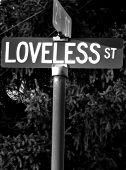 picture of loveless  - Street sign in small town of Ostrander Ohio marking the beginning of Loveless St - JPG