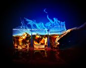 stock photo of absinthe  - Image of three glasses of burning yellow absinthe - JPG