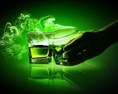 Two glasses of green absinthe