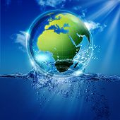 Save The World.Water Earth globe over ocean waves