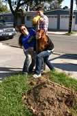 LOS ANGELES - FEB 9:  Theresa Castilo, Jason Thompson, and Emily Wilson removing old fence post at t