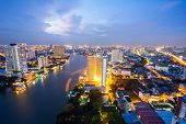 Aerial view of Bangkok Skyline along Chaophraya River at dusk