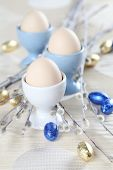 Eggs in white and blue eggcups