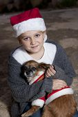 Girl With Dog In Christmas Costumes