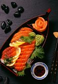 Salmon Sashimi On Black Slate Background