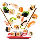 Delicious pieces of a fly sushi isolated on white background