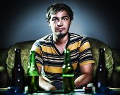 drunk young man on couch with beer