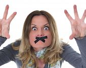 furious woman with sticky tape on her lips, shut up, do not spreed negative emotions