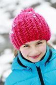 Winter, snow, winter fun - lovely girl enjoying winter