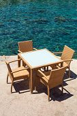 Table And Chairs By The Sea, Greece