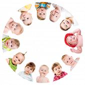 foto of huddle  - Group of smiling babies standing in huddle on white background - JPG