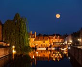 Canal and medieval houses in twilight. Bruges (Brugge), Belgium