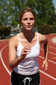 Athletic Girl Running At The Track