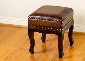 Leather Footstool On Traditional Oak Floors