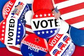 stock photo of voting  - A colorful collection of American national political vote badges - JPG