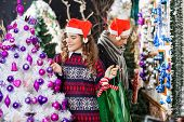 Young couple shopping for Christmas decorations in store