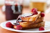 stock photo of french toast  - French toast with raspberry jam on a plate - JPG