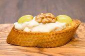 Bruschetta With Gorgonzola Cheese, Walnut And Grapes