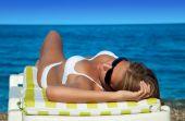 Beautiful Woman In Bikini Lying Back