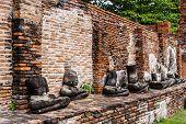 Row of broken buddha at Ayuttaya, Thailand