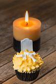 Halloween pumpkin cupcake and candle