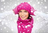 winter, people, happiness concept - woman in hat, muffler and mittens