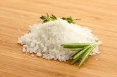 salt with fresh rosemary and and thyme on wooden background