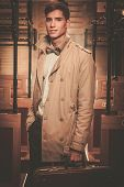 picture of coat tie  - Handsome young man with suitcase in coat inside vintage train coach - JPG