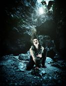 picture of woman dragon  - Sexy Woman with dragon in a cave - JPG
