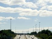 Highway Under Partly Cloudy Sky