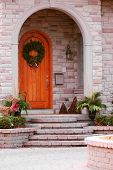 Entrance of a luxury house with natural stone landscaping